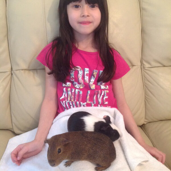 Jacille and her Guinea pigs George and Alex
